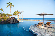 The Four Seasons Resort Hualalai at Historic Kaupulehu on the Big Island of Hawaii. The Sea Shell pool at dawn.