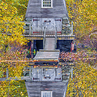 New England fall foliage peak colors framing The Old Manse Boathouse at the Minute Man National Historic Park near Concord, Lincoln and Lexington in Massachusetts.<br />
