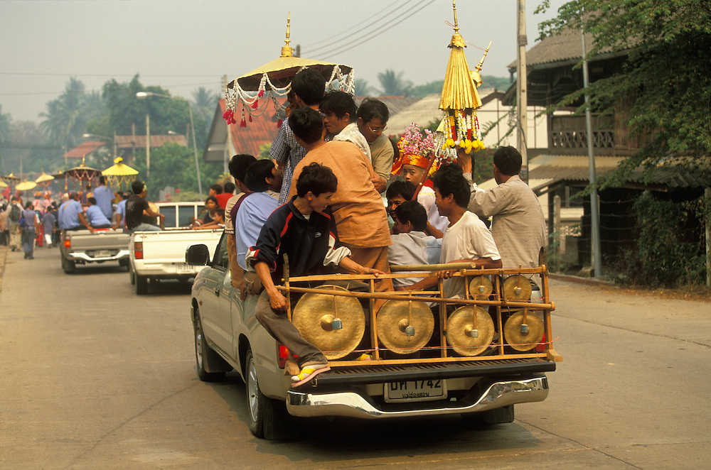 An overloaded pickup during the Poy Sang Long, the yearly ordination of novice monks, in Mae Hong Son, Thailand. Before the boys become novice monks they are dressed like princes and treated like royalty for three days, in honor of the Buddha. Their feet may not touch the ground, so they are carried by attendants, but when it is too far to walk, they may take a car.