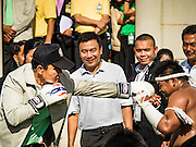 09 JANUARY 2016 - BANGKOK, THAILAND: PRAYUTH CHAN-O-CHA, the Prime Minister of Thailand, pretends to spar with students during Children's Day festivities at Government House. National Children's Day falls on the second Saturday of the year. Thai government agencies sponsor child friendly events and the military usually opens army bases to children, who come to play on tanks and artillery pieces. This year Thai Prime Minister General Prayuth Chan-ocha, hosted several events at Government House, the Prime Minister's office.        PHOTO BY JACK KURTZ