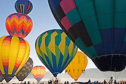 Group of hot air balloons ready to lift off in Taos NM.<br />