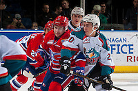 KELOWNA, CANADA - JANUARY 4: Conner Bruggen-Cate #20 of the Kelowna Rockets checks Alex Mowbray #12 of the Spokane Chiefs on January 4, 2017 at Prospera Place in Kelowna, British Columbia, Canada.  (Photo by Marissa Baecker/Shoot the Breeze)  *** Local Caption ***
