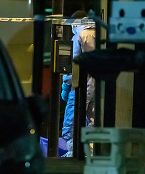 © Licensed to London News Pictures. 02/02/2020. London, UK. Forensic officers stand over a bag on the floor on Streatham High Road, as where shoppers were lead to safety. Terror attack in Streatham South London as Police shoot dead a knife-wielding suspect in a suicide vest after two people were stabbed. Photo credit: Alex Lentati/LNP
