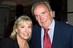 © Licensed to London News Pictures. 08/04/2014. London, UK. Nadine Dorries at the launch party of her first novel, The Four Sisiters. The party took place at the Intercontinental Hotel at Westminster. Nadine with Anthony Cheetham the publisher. Photo credit : Simon Ford/LNP