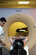 A woman with breast cancer undergoes a CT (Computed Tomography) scan