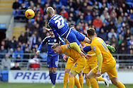 Cardiff City's Lex Immers (27) rises above Tom Clarke of Preston (5) to win a header. Skybet football league championship match, Cardiff city v Preston NE at the Cardiff city stadium in Cardiff, South Wales on Saturday 27th Feb 2016.<br /> pic by Carl Robertson, Andrew Orchard sports photography.