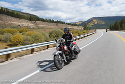 Jon Neuman riding his 1928 Harley-Davidson JD during Cris Sommer Simmons riding her 1934 Harley-Davidson VD during Stage 10 (278 miles) of the Motorcycle Cannonball Cross-Country Endurance Run, which on this day ran from Golden to Grand Junction, CO., USA. Monday, September 15, 2014.  Photography ©2014 Michael Lichter.
