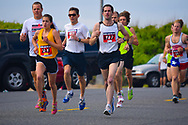 Spring Lake, NJ 07762 - May 24, 2014. Woman in the lead in the annual Spring Lake 5k race. Editorial Use Only.