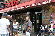 6/25/21 Minneapolis Minnesota <br /> Pictured is Samir Abumayyaleh, owner of Cup Foods where George Floyd was murdered. He is pictured in George Floyd Memorial Square outside his store he has owned fro 31 years, during the reading of the Derek Chauvin sentencing. Chauvin was sentenced to 22.5 years and is the harshest sentence ever given a police officer in Minnesota. The local community has mixed emotions regarding the sentencing and feels that there is much work that still needs to be done. Samir Abumayyaleh, owner of Cup Foods where George Floyd was brutally murdered by Derek Chauvin, listens to the sentencing and talks to members of the local community.  Photo © Suzi Altman