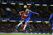 Oscar of Chelsea heads the ball over Andrew Surman of Bournemouth. Barclays Premier league match, Chelsea v AFC Bournemouth at Stamford Bridge in London on Saturday 5th December 2015.<br /> pic by John Patrick Fletcher, Andrew Orchard sports photography.