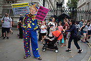 Anti Brexit protester dressed up as a clown version of Prime Minister Boris Johnson outside the Downing Street in Westminster as it is announced that Boris Johnson has had his request to suspend Parliament approved by the Queen on 28th August 2019 in London, England, United Kingdom. The announcement of a suspension of Parliament for approximately five weeks ahead of Brexit has enraged Remain supporters who suggest this is a sinister plan to stop the debate concerning a potential No Deal.