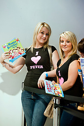 """Samantha Parfitt (left) and Sophie Greaves (right) at the fron of the queue waiting for Peter Andre to Sign copies of his new childrens books """"The Happy Birthday Party"""" and """"A New Day at School"""" at WH Smiths Meadowhall Sheffield on 6th September2011 Image © Paul David Drabble"""