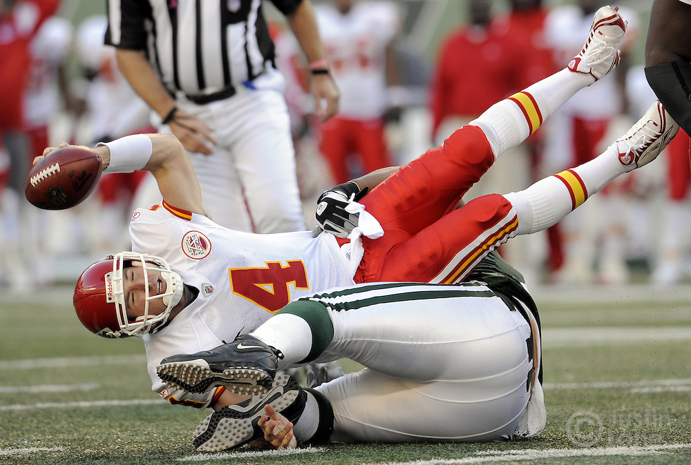 The Chiefs' Tyler Thigpen (L) is brought down by the Jets' Kris Jenkins (R) during the fourth quarter of the game between the Kansas City Chiefs and the New York Jets at Giants Stadium in East Rutherford, New Jersey on 26 October 2008. The Jets won, 28-24.
