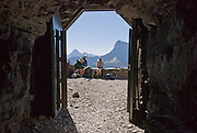 """In 1930, the Ptarmigan Tunnel was dug 183 feet through the Ptarmigan Wall for hikers from Many Glacier to reach the Belly River Valley in Glacier National Park, Montana, USA. Since 1932, Canada and USA have shared Waterton-Glacier International Peace Park, which UNESCO declared a World Heritage Site (1995) containing two Biosphere Reserves (1976). Rocks in the park are primarily sedimentary layers deposited in shallow seas over 1.6 billion to 800 million years ago. During the tectonic formation of the Rocky Mountains 170 million years ago, the Lewis Overthrust displaced these old rocks over newer Cretaceous age rocks. Glaciers carved spectacular U-shaped valleys and pyramidal peaks as recently as the Last Glacial Maximum (the last """"Ice Age"""" 25,000 to 13,000 years ago). Of the 150 glaciers existing in the mid 1800s, only 25 active glaciers remain in the park as of 2010, and all may disappear by 2020, say climate scientists."""