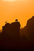 Greece, Thessaly, Meteora, Silhouette of the Monastery of St Nikolaous at dusk