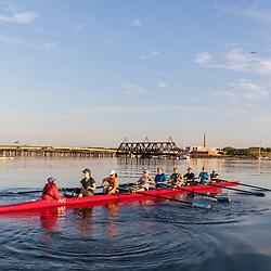 A morning rowing club (Portland Community Rowing Association) rows in Portland, Maine. Casco Bay.