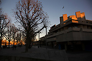 Autumn scene with sun setting on the National Theatre on the Southbank riverside walkway, London, United Kingdom. The South Bank is a significant arts and entertainment district, and home to an endless list of activities for Londoners, visitors and tourists alike. (photo by Mike Kemp/In Pictures via Getty Images)