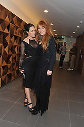 Left to right, TALLULAH HARLECH and CHARLOTTE TILBURY at the launch of famed American fitness club 'Equinox' 99 High Street Kensington, London on 23rd October 2012.