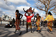 A walk along the River Thames on the Southbank in London. African acrobatics street entertainers perform. This area is very popular especially on the weekends for Londoners to walk and see different arts, culture and entertainment.