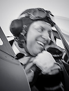 WWII Royal Air Force Pilot re-enactor in the cockpit of a WWII era British Royal Navy Seafire F. XV.  Created during AirVenture in Oshkosh, Wisconsin.  <br /> <br /> Created by aviation photographer John Slemp of Aerographs Aviation Photography. Clients include Goodyear Aviation Tires, Phillips 66 Aviation Fuels, Smithsonian Air & Space magazine, and The Lindbergh Foundation.  Specialising in high end commercial aviation photography and the supply of aviation stock photography for advertising, corporate, and editorial use.