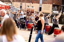 Taiko Drummers perform at Exeter Quay as Exeter Chiefs players row Dragon Boats down the Quay wearing the new Home and European Kits for the 2019/20 Season - Ryan Hiscott/JMP - 19/07/2019 - SPORT - Exeter Quay - Exeter, England - Exeter Chiefs Kit Launch