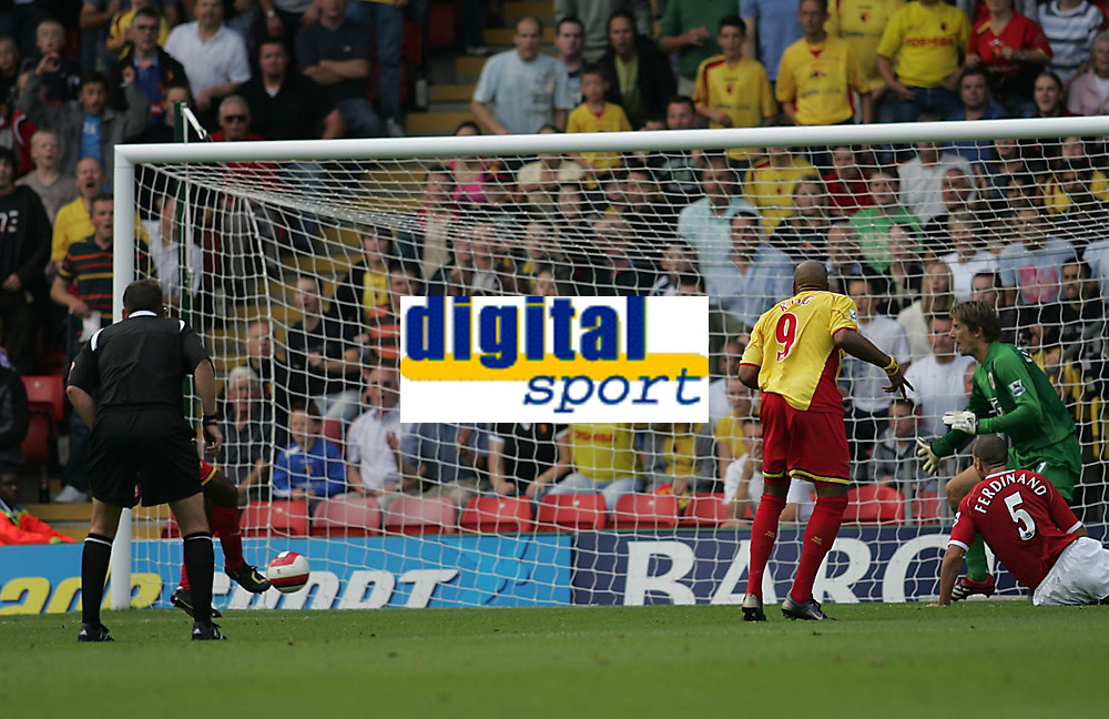 Photo: Lee Earle.<br /> Watford v Manchester United. The Barclays Premiership. 26/08/2006. Watford's Damien Francis (behind ref) scores their first goal.