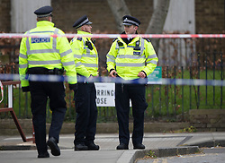 © Licensed to London News Pictures. 02/04/2019. London, UK. Police guard a cordon in Kentish Town, north London, where a man in his 20s was found with fatal stab wounds at 8.30 pm on 1st April.  Another man has been stabbed in Edmonton this morning. Photo credit: Peter Macdiarmid/LNP