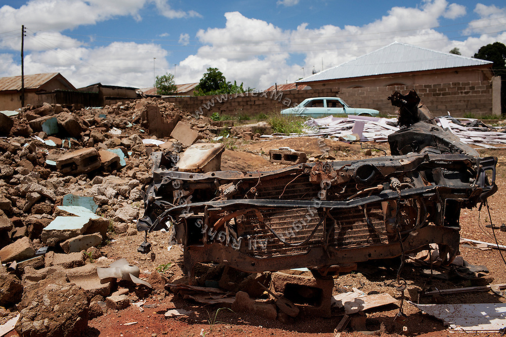 Parts of a car, once used by a suicide bomber, are left amid rubble where a Pentecostal church was once standing in the Christian-majority neighbourhood of Kabong, Jos, Plateau State, Nigeria. Christ Chosen Church was demolished by the bomb blast on June 11th, 2012. Shortly after, iIrate Christian youth mobs went into an offensive, killing at least 7 innocent Muslims and injuring many others.