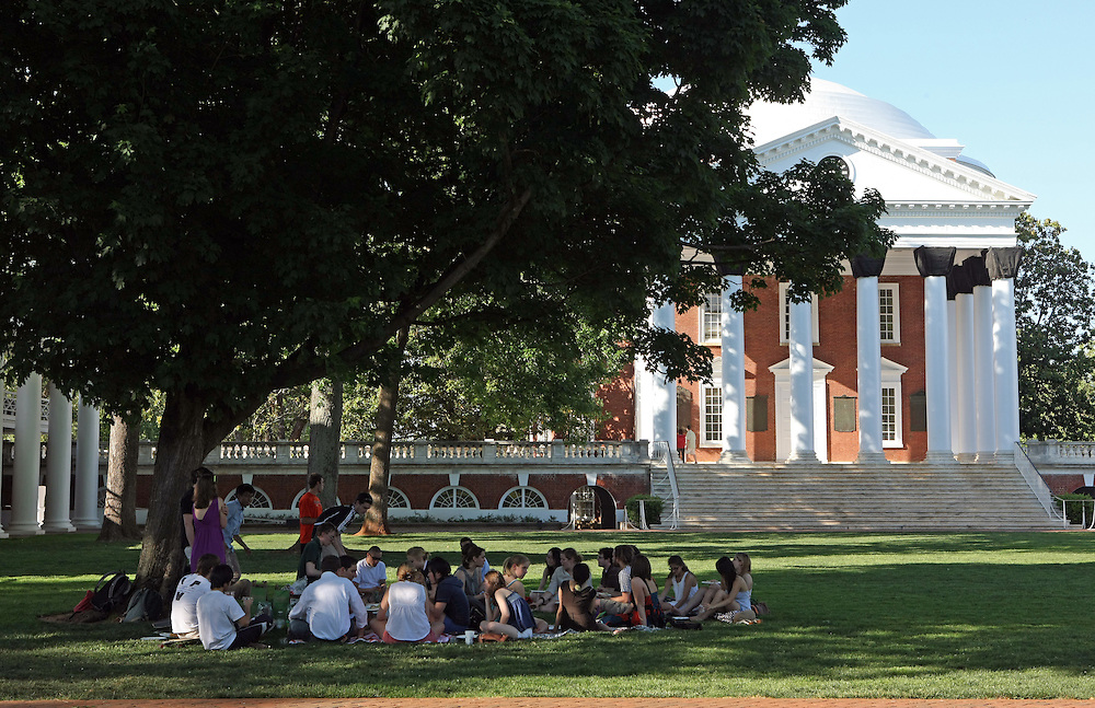 Students sit in a group on the lawn at the University of Virginia Thursday May 6, 2010 just one day after a candlelight vigil was held in memory of former student Yeardley Love, a women's lacrosse player who was killed in her apartment earlier this week in Charlottesville, Va. George Huguely, 22, a member of UVa's nationally ranked men's lacrosse team, faces a first-degree murder charge in the slaying of Yeardley Love, also 22. (Credit Image: © Andrew Shurtleff)..