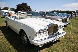 © Licensed to London News Pictures. 07/08/2016. Leeds UK. Picture shows a white convertible Rolls Royce Corniche 2 at the 37th Rolls Royce North rally that has taken place this weekend in the ground's of Harewood House in Yorkshire. The event bring's together some of the UK's most prized motor cars & their proud owners. Photo credit: Andrew McCaren/LNP