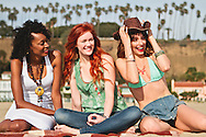 Girls enjoying each other's company at the beach.