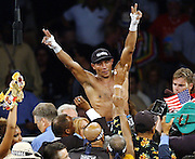 Ricardo Mayorga celebrates his 12-round, majority decision over Vernon Forrest in their WBC/WBA welterweight championship bout at the Orleans Arena in Las Vegas, Saturday, July 12, 2003. Colin Braley)