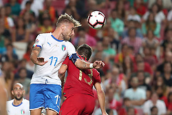 September 10, 2018 - Lisbon, Portugal - Italy's forward Ciro Immobile (L) heads the ball with Portugal's midfielder Ruben Neves during the UEFA Nations League A group 3 football match Portugal vs Italy at the Luz stadium in Lisbon, Portugal on September 10, 2018. (Credit Image: © Pedro Fiuza/ZUMA Wire)
