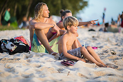 Family relaxing on sand at beach, Mauritius