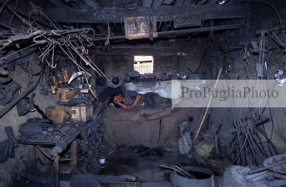 An ironmonger slepping in his store