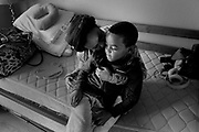 Nichole Creer and her son Demareau Davis, 5, at their new room. Creer found a place to stay because of Safe Time, a new nonprofit that seeks to temporarily house families who are at-risk of homelessness in the homes of volunteer hosts.