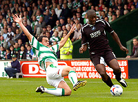 Photo: Alan Crowhurst.<br />Yeovil Town v Swansea. Coca Cola League 1. 08/10/2005. Kevin Austin (R) of Swansea takes on the Yeovil defence.