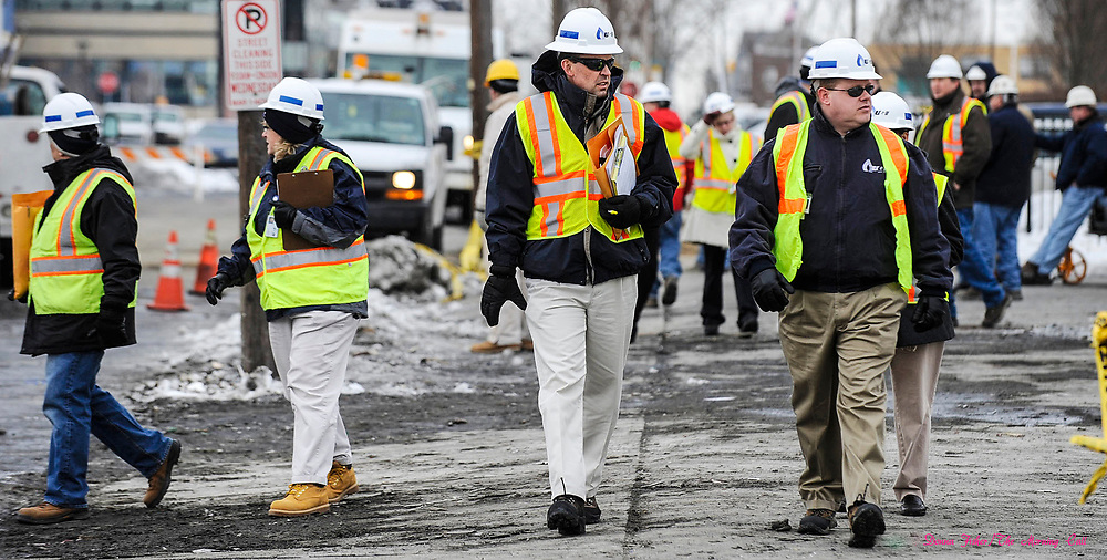 UGI workers fan out after their meeting at N. 13th Street at Allen Street Saturday morning as they went to knock on resident's doors to answer questions and provide help. Gas explosion at 13th and Allen Streets, Allentown, Pa. which happened on the night of February 9, 2011. Scene at 13th and Allen.   ////            DONNA FISHER/THE MORNING CALL     ALLENTOWN