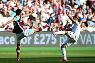 Jonathan Calleri of West Ham United (L) & Kyle Naughton of Swansea City (R) battle for the ball. Premier league match, West Ham Utd v Swansea city at the London Stadium, Queen Elizabeth Olympic Park in London on Saturday 8th April 2017.<br /> pic by Steffan Bowen, Andrew Orchard sports photography.