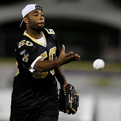 Apr 28, 2010; Metairie, LA, USA; Marvin Mitchell (50) pitches the ball during the Heath Evans Foundation charity softball game featuring teammates of the Super Bowl XLIV Champion New Orleans Saints at Zephyrs Field.  Mandatory Credit: Derick E. Hingle-US-PRESSWIRE.