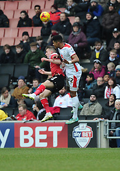Bristol City's Joe Bryan battles for the high ball with Milton Keynes Dons' Jordan Spence  - Photo mandatory by-line: Joe Meredith/JMP - Mobile: 07966 386802 - 07/02/2015 - SPORT - Football - Milton Keynes - Stadium MK - MK Dons v Bristol City - Sky Bet League One
