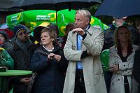 """20 SEP 2013, BERLIN/GERMANY:<br /> Renate Kuenast (L), B90/Gruene, Fraktionsvorsitzende, und Juergen Trittin (R), B90/Gruene, Spitzenkandidat, unter einem Schirm, waehrend einer Wahlkampfveranstaltung """"Wahlkampfhoehepunkt"""", Wahlkampf zur Bundestagswahl 2013, RAW Tempel, Revaler Straße 99, Berlin-Friedrichshain <br /> IMAGE: 20130920-02-058<br /> KEYWORDS: Wahlkampf, Veranstaltung, Renate Künast, Jürgen Trittin"""