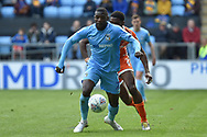 Coventry City striker Amadou Bakayoko (21) battles for possession during the EFL Sky Bet League 1 match between Coventry City and Shrewsbury Town at the Ricoh Arena, Coventry, England on 28 April 2019.