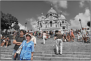 Day Tripper - Paris Mont Matre is a  selective colour street photography series by photographer Paul Williams of tourists enjoying a sunny day visit to the Mont Matre Paris taken on 15th July 2007.