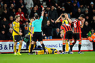 AFC Bournemouth defender Simon Francis is shown a red card by Referee Michael Oliver for a bad tackle on Aaron Ramsey (8) of Arsenal during the Premier League match between Bournemouth and Arsenal at the Vitality Stadium, Bournemouth, England on 3 January 2017. Photo by Graham Hunt.