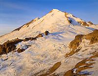 Mt. Baker, WA, USA.Dormant Volcano, 10,778Ft / 3285m..Mt. Baker Wilderness Area..Sunrise Alpenglow from Portal Peaks..4x5 Transparency.Brett Baunton.