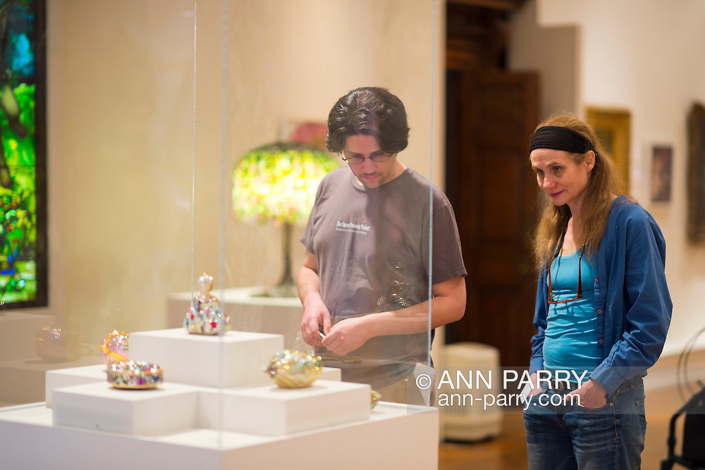 Roslyn, New York, U.S. - April 12, 2014 - During International Slow Art Day, visitors view, visitors view a rhinestone Minaudiere collection at the Garden Party exhibit at the Nassau County Museum of Art on Long Island. During this annual worldwide event, those participating went to local museums and viewed a small number of works of art, each for at least 10 minutes, and then discussed them afterward.