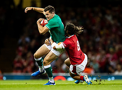 Jacob Stockdale of Ireland Wales is tackled by Josh Navidi of Wales<br /> <br /> Photographer Simon King/Replay Images<br /> <br /> Friendly - Wales v Ireland - Saturday 31st August 2019 - Principality Stadium - Cardiff<br /> <br /> World Copyright © Replay Images . All rights reserved. info@replayimages.co.uk - http://replayimages.co.uk