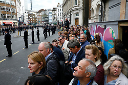 © Licensed to London News Pictures.10/04/2017.London, UK. Members of the public line the streets around Southwark Cathedral in London ahead od the funeral of PC Keith Palmer. PC Palmer was murdered just inside the gate by Westminster attacker Khalid Masood - an attack in which he also killed four people on Westminster Bridge.Photo credit: Tom Nicholson/LNP