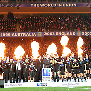 Richie McCaw the New Zealand captain is presented with the IRB Rugby World Cup after the All Blacks defeated France 8-7 in the final at the IRB Rugby World Cup tournament, Eden Park, Auckland, New Zealand. 23rd October 2011. Photo Tim Clayton...